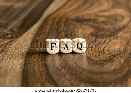 FAQ word background on wood blocks - stock photo