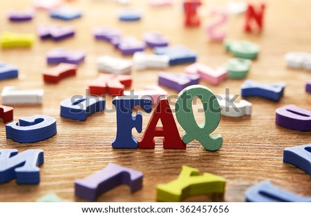 FAQ- words  made from multicolored   letters on wooden  background - stock photo