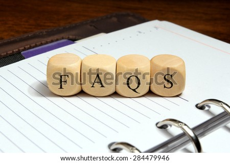 FAQS word concept on notebook  - stock photo