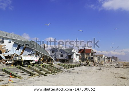 FAR ROCKAWAY, NY - FEBRUARY 28: Destroyed beach houses four months after  Hurricane Sandy on February 28, 2013 in Far Rockaway, NY  - stock photo