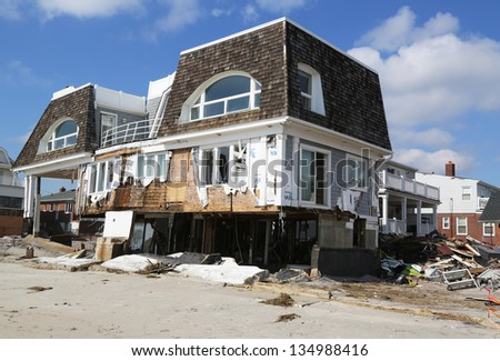 FAR ROCKAWAY, NY - FEBRUARY 28: Destroyed beach houses three months after  Hurricane Sandy on February 28, 2013 in Far Rockaway, NY - stock photo