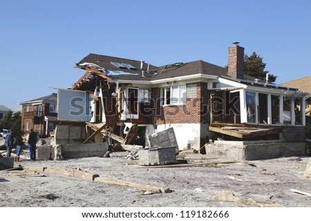FAR ROCKAWAY, NY - NOVEMBER 11: Destroyed beach houses in the aftermath of Hurricane Sandy on November 11, 2012 in Far Rockaway, NY