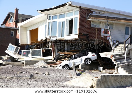 FAR ROCKAWAY, NY - NOVEMBER 11: Destroyed beach houses in the aftermath of Hurricane Sandy on November 11, 2012 in Far Rockaway, NY - stock photo