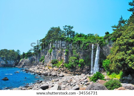 Far shot of majestic waterfall with sky background - stock photo