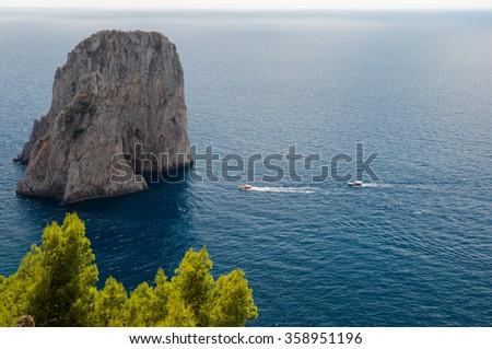 Faraglioni and Tyrrhenian sea at Capri - Italy - stock photo