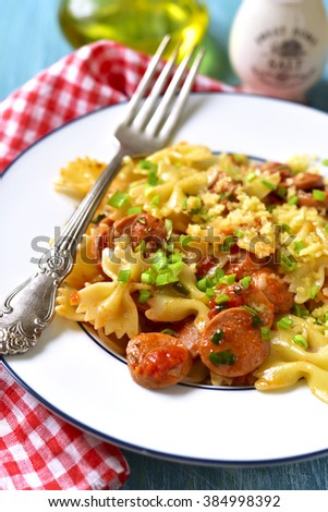 Farfalle with sausage in tomato sauce.Vintage style.