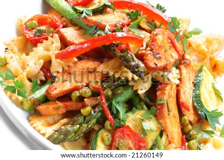 Farfelle ribbon bow pasta with smoked chicken and vegetables.  A delicious, healthy salad. - stock photo