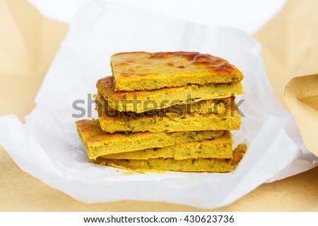 Farinata (chickpea flour pancake, olive oil, salt and water, Italy) - stock photo