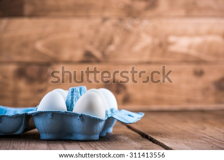 Farm fresh free range eggs on wooden background - stock photo