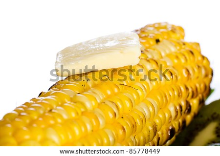 Farm fresh yellow corn on the cob with butter melting over the top.