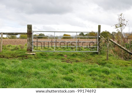 Farm Gate in a Green Field - stock photo
