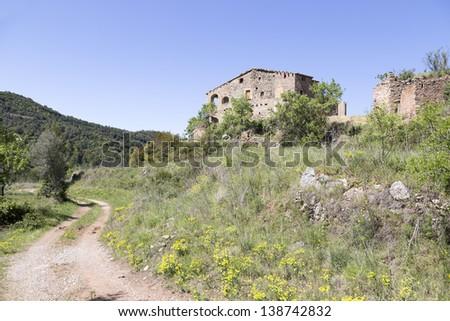 Farm house near Mura in Catalonia, Spain. - stock photo