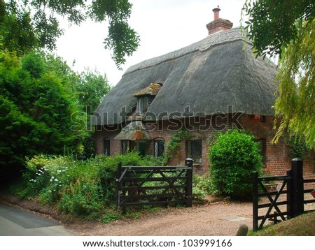 Farm house whit an thatched roof - stock photo