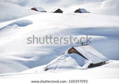 Farm houses buried under snow, Melchsee-Frutt, Switzerland  - stock photo