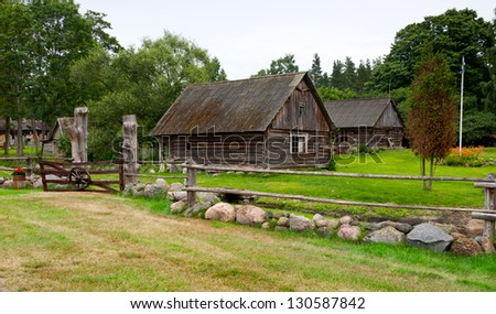 Farm houses with large green garden and timber and cobble stone yard