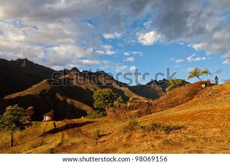 Farm in the mountains  in beautiful evening light - stock photo