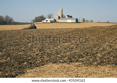 Farm Work after harvest- seen in November. - stock photo