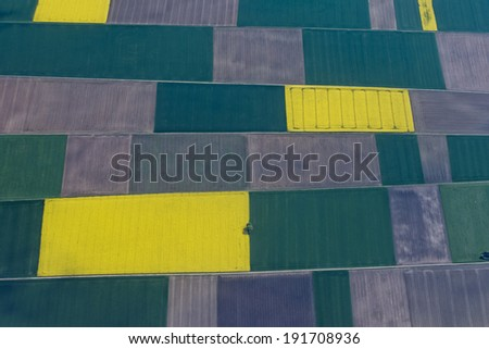farmed fields aerial view from airplane - stock photo