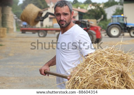 Farmer bailing hay - stock photo