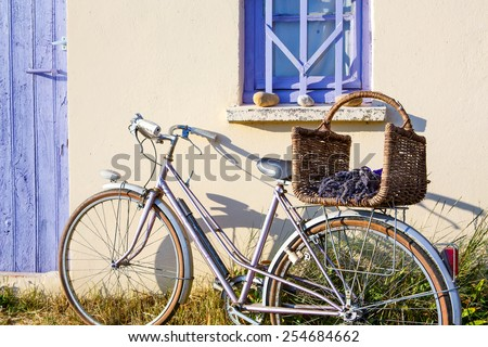 Farmer house near lavender fields near Valensole in Provence, France. With bike, lavender bouquet in basket with typical provencal style. - stock photo