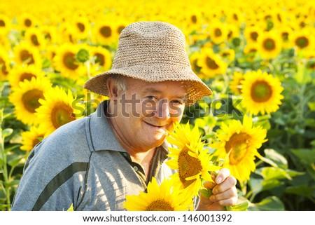 farmer in sunflower field - stock photo