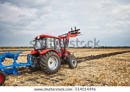 Young Farmer Standing On Tractor Field Stock Photo ...