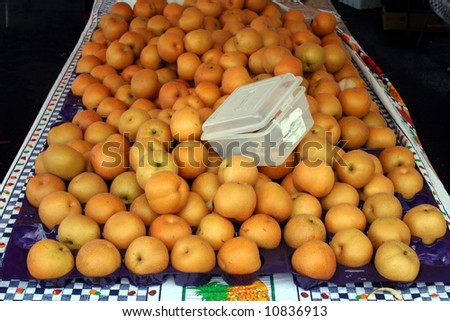 farmer's market tangelo display with sample bin - stock photo