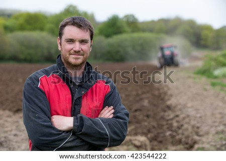farmer showing new tractor