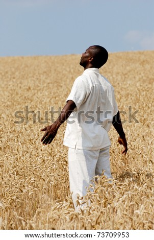 Farmer staying in the middle of the field