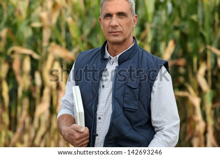 Farmer with computer - stock photo