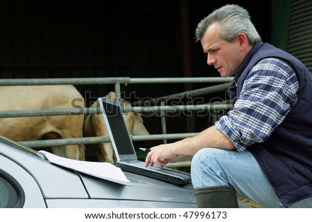 Farmer with laptop computer