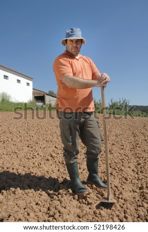 farmer working on the farm - stock photo