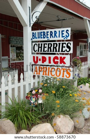 Farmers fruit signs at U-pick farm in Michigan in Summer - stock photo