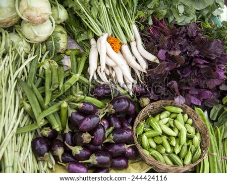 farmers market selling fresh vegetables and fruits - stock photo