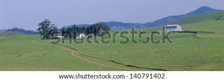 Farmhouse and barn near Cambria, California - stock photo