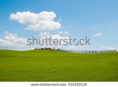 Farmhouse and cypress trees in Tuscany, Typical italian landscape in the spring season. - stock photo