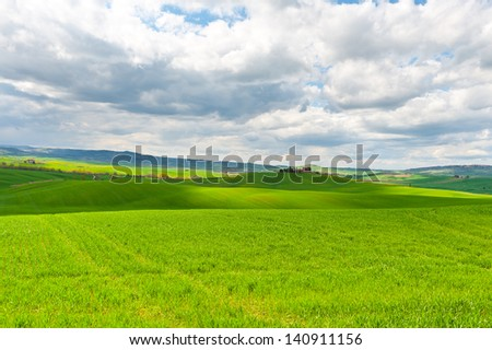 Farmhouse and Green Sloping Meadows of Tuscany