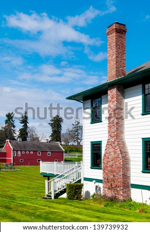 Farmhouse and red barn - stock photo