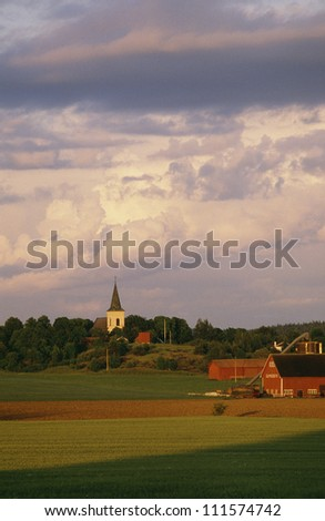 Farmhouse and steeple - stock photo