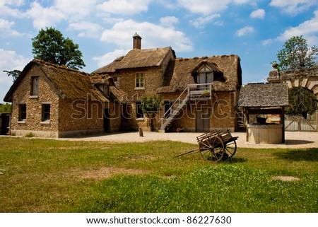 Farmhouse at Marie Antoinette's hamlet at Versailles, France - stock photo