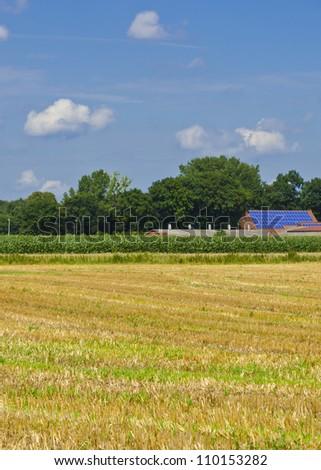 farmhouse with solar modules - stock photo