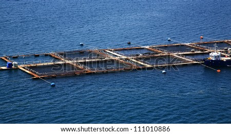 Farming fish in the sea Kefalonia Greece - stock photo