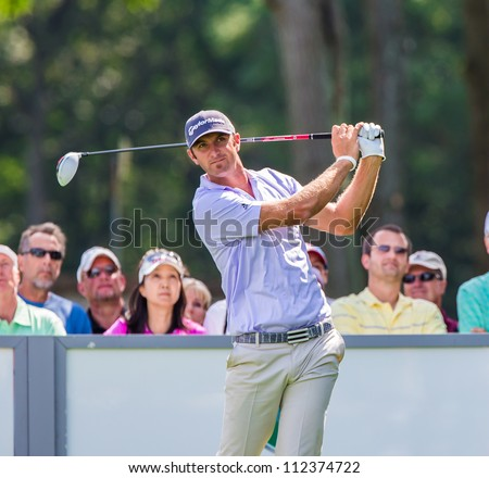 FARMINGDALE, NY - AUGUST 21: Long Hitting Dustin Johnson hits a drive at Bethpage Black during the Barclays on August 21, 2012 in Farmingdale, NY. - stock photo