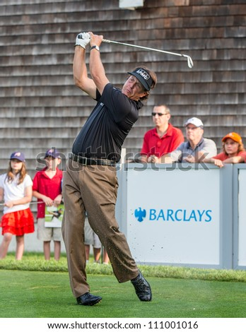 FARMINGDALE, NY - AUGUST 21: Phil Mickelson hits a drive at Bethpage Black during the Barclays on August 21, 2012 in Farmingdale, NY. - stock photo