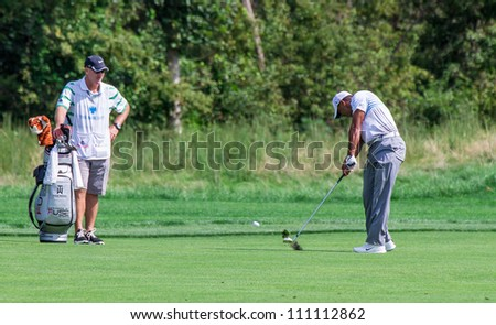 FARMINGDALE, NY - AUGUST 22: Tiger Woods hits a hot at Bethpage Black during the Barclays on August 22, 2012 in Farmingdale, NY. - stock photo
