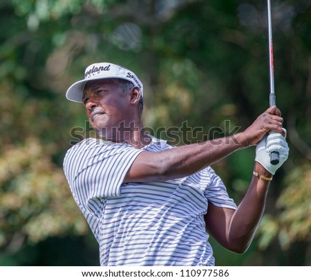 FARMINGDALE, NY - AUGUST 21: Vijay Singh hits a tee shot at Bethpage Black during the Barclays on August 21, 2012 in Farmingdale, NY. - stock photo