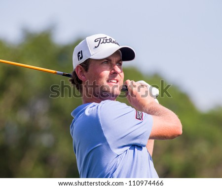 FARMINGDALE, NY - AUGUST 22: Webb Simpson hits a drive at Bethpage Black during the Barclays on August 22, 2012 in Farmingdale, NY. - stock photo