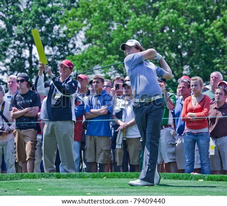 FARMINGDALE, NY - JUNE 15: Rory McIlroy hits his drive on the 6th hole during the 2009 US Open at Bethpage Black on June 15, 2009 in Farmingdale, NY. - stock photo