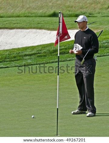 FARMINGDALE, NY - JUNE 16: Tiger Woods surveys the difficult 17th green on the Black Course during the 2009 US Open on June 16, 2009 in Farmingdale, NY. - stock photo