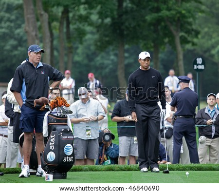 FARMINGDALE, NY - JUNE 16: Tiger Woods visualizes his tee shot off the difficult 12th hole on the Black Course during the 2009 US Open on June 16, 2009 in Farmingdale, NY. - stock photo